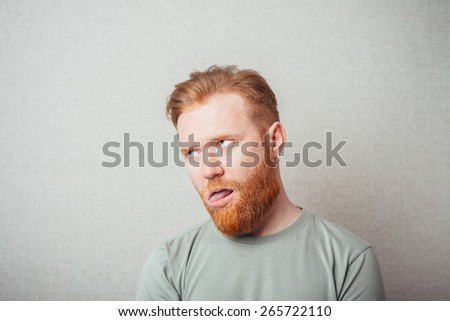 young man showing his tongue doing a joke - stock photo