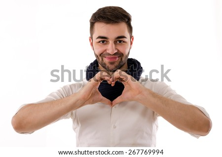 Young man showing love symbol with his hands - stock photo