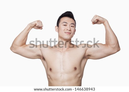 Young man showing off biceps