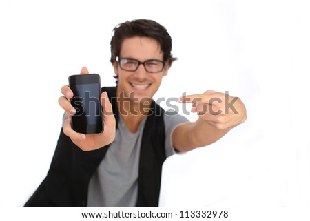 Young man showing smartphone screen to camera - stock photo