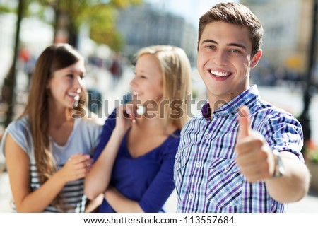 Young man showing thumbs up - stock photo