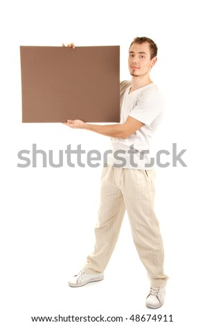 Young man shows by finger on a brown empty board for your text