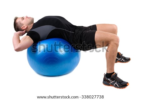 Young man shows starting position of Abdominal Fitball Workout, isolated on white