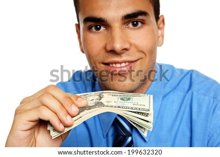 Young man shows you a bundle of banknotes, focus is on money - stock photo