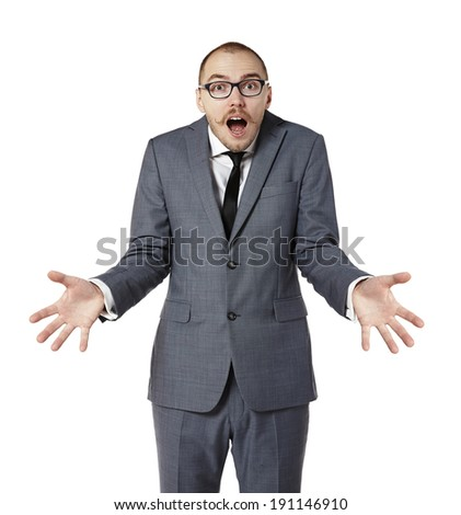 Young man shrugging his shoulders. Man gesturing with hands. Isolated on white. - stock photo