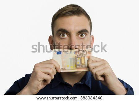 Young man silenced by a fifty euro banknote isolated on white background - stock photo