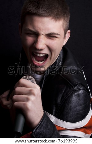 Young man singing some song - stock photo