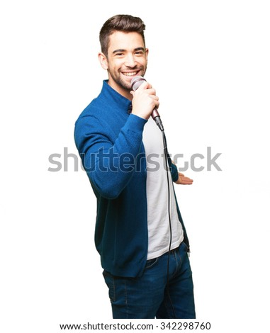 young man singing with a microphone - stock photo