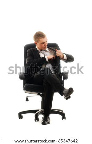 Young man sitting in chair. Isolated over white.