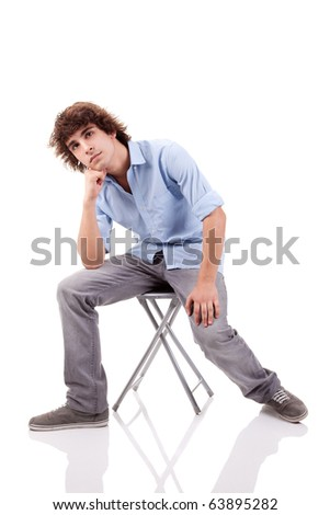 young man, sitting on a bench, isolated on white  background - stock photo