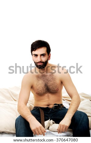 Young man sitting on the bed.