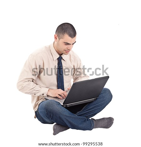 Young man sitting on the floor and work with laptop computer