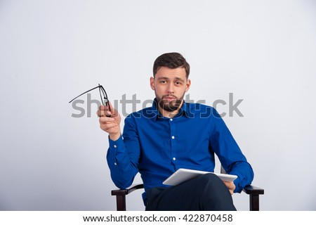 young man sitting with a tablet - stock photo