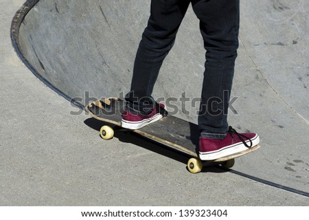 Young man skateboarding on his skateboard in the park. - stock photo