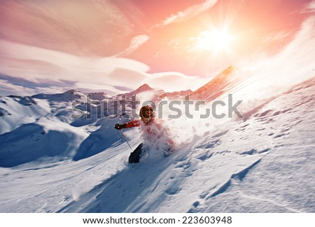 Young man skiing in powder snow - stock photo