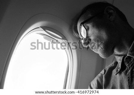 Young man sleeping in the in airplane.