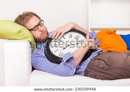 Young man sleeping on the couch  - studio shoot  - stock photo