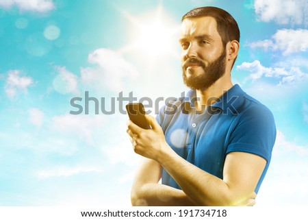 Young man smile and holding a phone - stock photo
