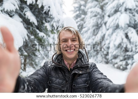 Young Man Smile Camera Taking Selfie Photo In Winter Snow Forest Guy Outdoors Walking White Park