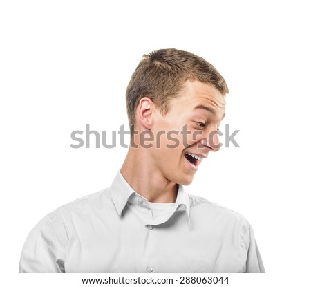 Young man smiling and looking down. Isolated on white. - stock photo