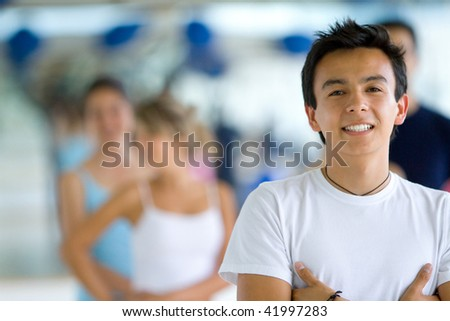 young man smiling and looking happy at the gym