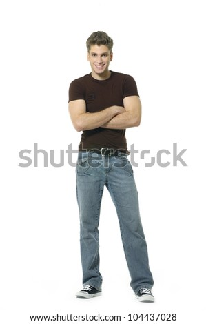 young man smiling arms crossed at camera. - stock photo