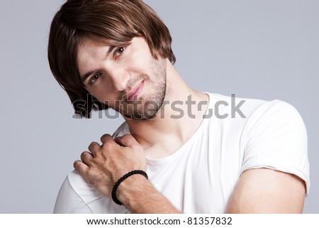 young man smiling, studio shot - stock photo