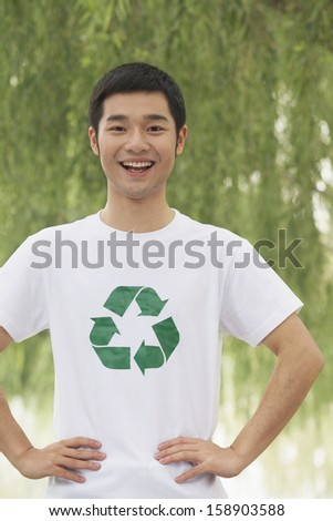 Young man smiling with recycling symbol