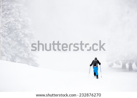 Young Man Snowshoeing Through Heavy Snow - stock photo