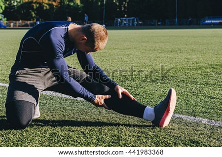 Young man soccer player get ready to the game - stock photo