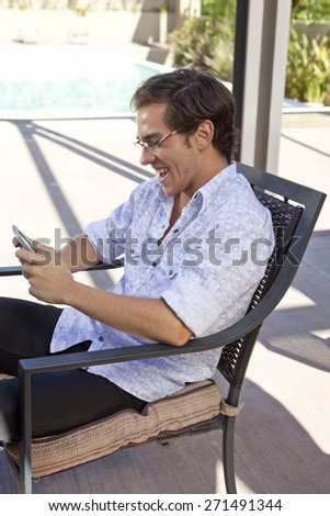 Young man speaking on smart phone wearing glasses - stock photo