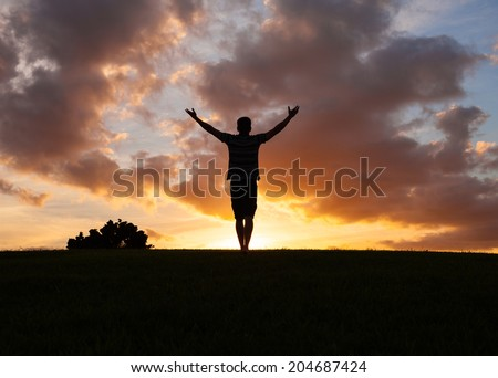 Young man spreading hands with joy and inspiration. - stock photo