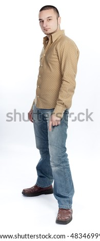 Young man standing - stock photo