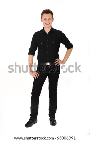Young man standing and smiling on white background