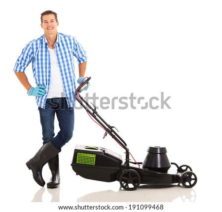 young man standing next to lawnmower on white background - stock photo