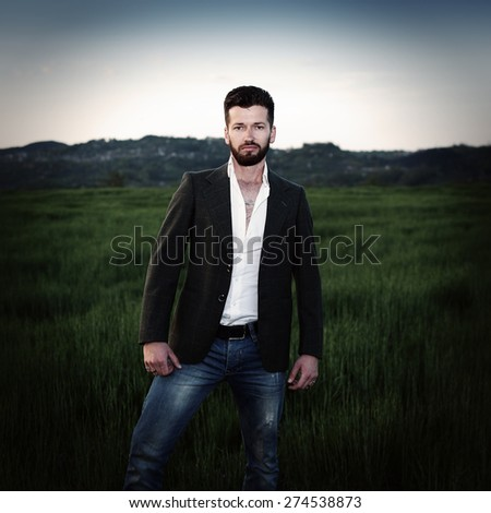 young man standing on a meadow