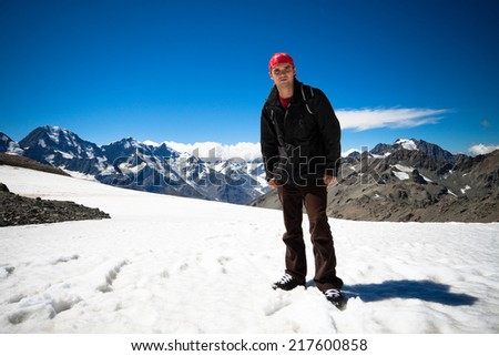 Young man standing on peak of Mount Cook the highest mountain in New Zealand. - stock photo