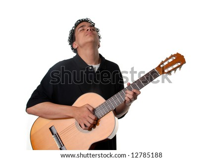 Young man standing playing an acoustic guitar - stock photo