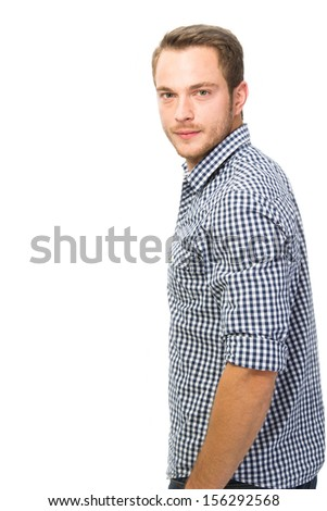 Young man standing with serious face - stock photo