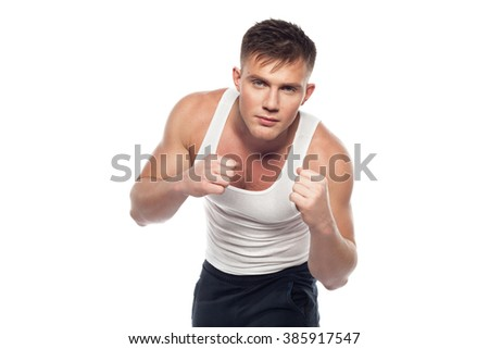 young man stands in a fighting stance