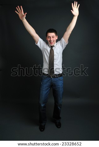 Young man staying with two hands up
