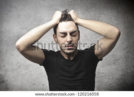 Young man stressed - stock photo