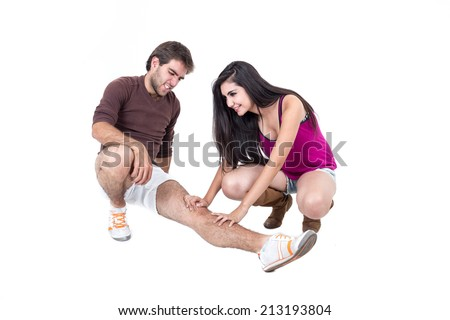 Young man stretching with happy female personal trainer isolated on white - stock photo