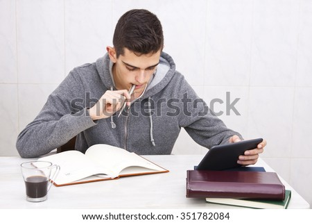 young man studying at home, lifestyle - stock photo
