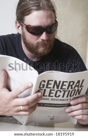 young man studying the General Election guidelines to figure out how to vote