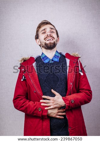 Young man suffering from a bad stomach ache pain - stock photo