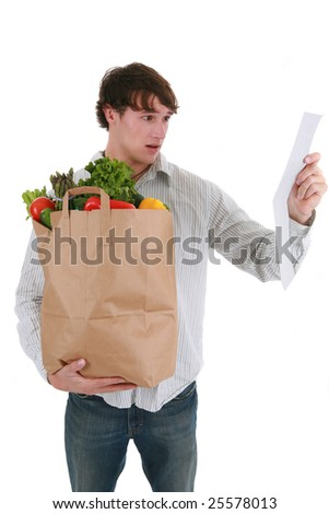 Young Man Surprised Expression Looking at Groceries Store Receipt