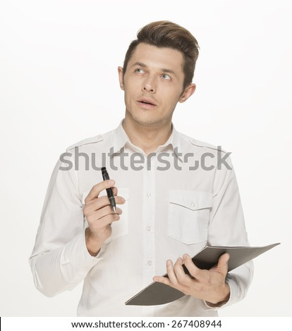 Young man taking notes, isolated on white