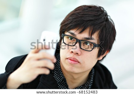 young man taking picture with mobile phone - stock photo