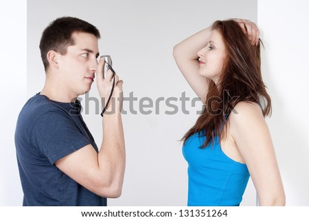 young man taking pictures of his girlfriend